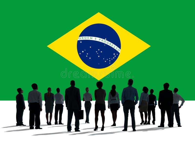 Begrepp för Brasilien nationsflaggagrupp människor arkivfoto