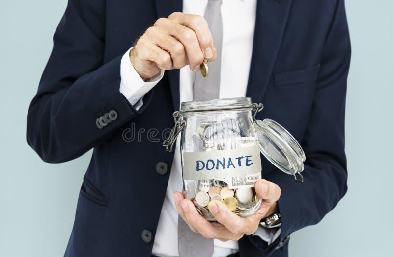 Begrepp för finans för donationvälgörenhetpengar royaltyfria bilder