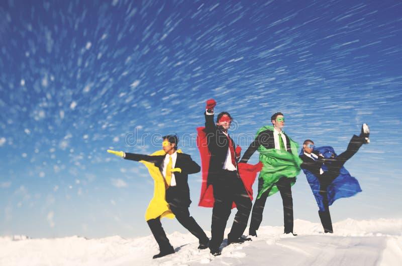Begrepp för räddningsaktion för snö för affärsSuperheroesvinter royaltyfri fotografi