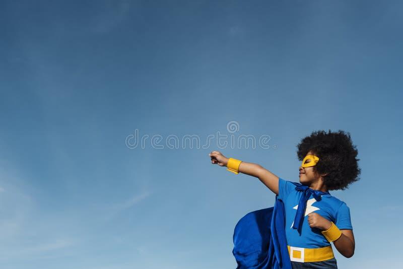Begrepp Little Boy för toppen hjälte arkivfoto