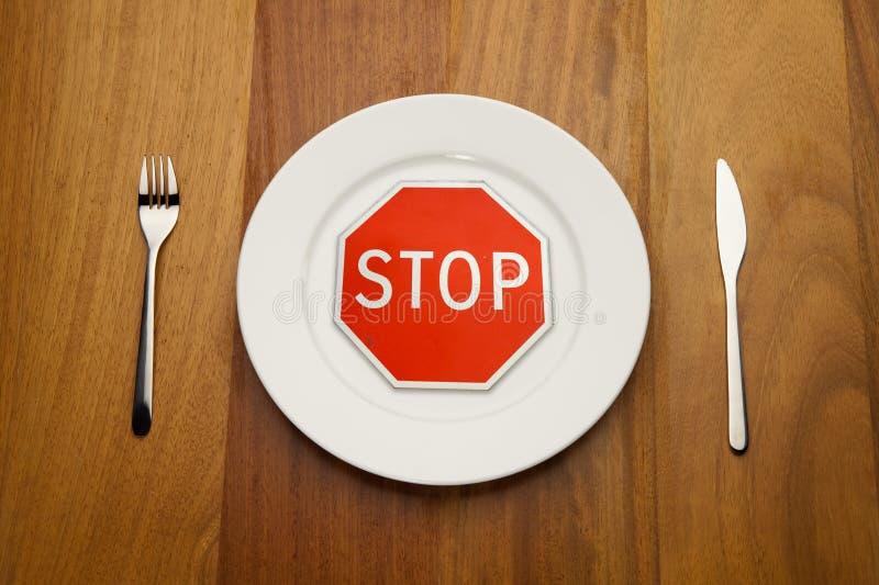 begreppet bantar äter stoppet arkivfoto