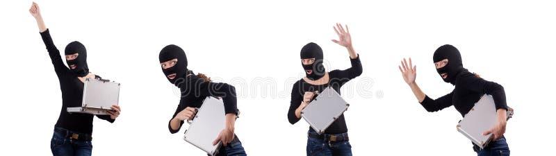 Begreppet f?r industriellt spionage med personen i balaclava arkivfoto