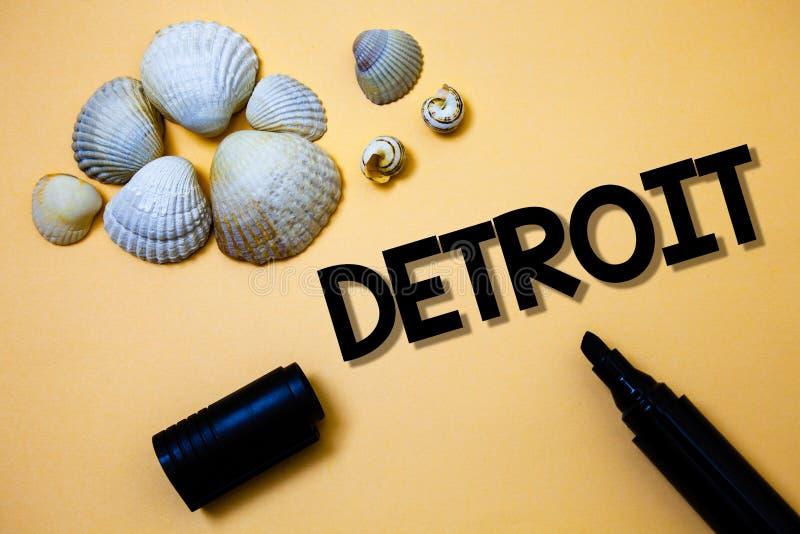 Begreppsmässig handhandstil som visar Detroit Stad för affärsfototext i Amerikas förenta staterhuvudstaden av Michigan Motown Yel royaltyfria foton