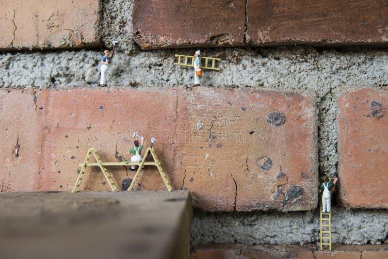 Begreppsmässig miniatyr fotografering för bildbyråer
