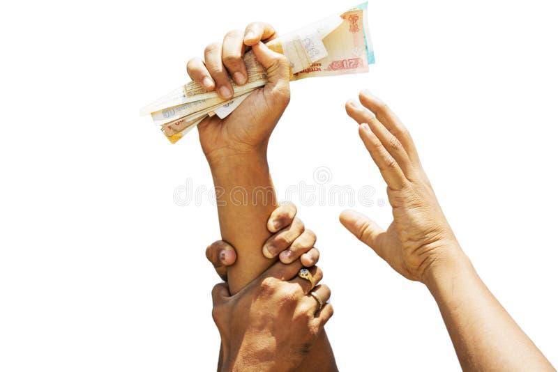 Begreppsvisning av girighet för pengar, händer som försöker att gripa pengar från en andra personhänder royaltyfri fotografi