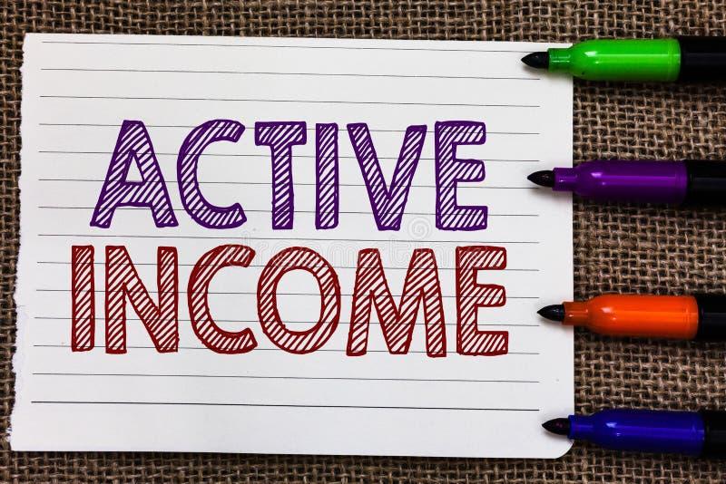 Begriffshandschrift, die aktives Einkommen zeigt Geschäftsfoto Präsentationsabgaben-Gehalts-Pensionen finanziell lizenzfreie stockfotografie
