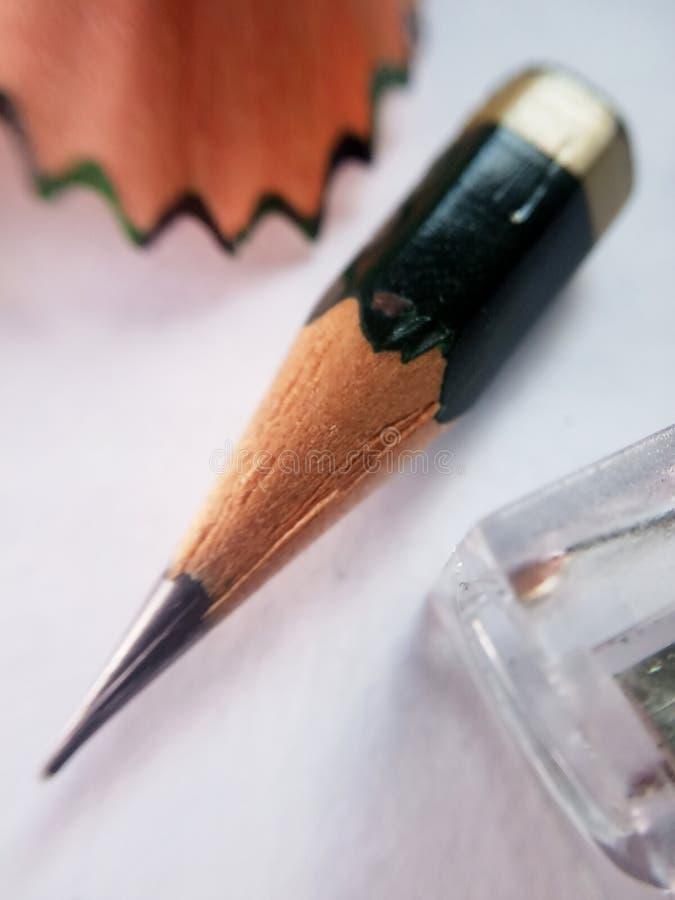 Begriffsmakro, Illustration für Keep kämpfend bis die letzte Gelegenheit, kleiner Bleistift und Bleistiftspitzer der Perspektiven lizenzfreie stockfotografie