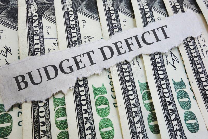 Begroting Tekort nieuws over geld stock afbeeldingen