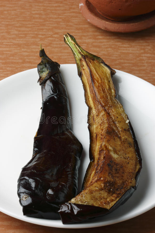 Begun Bhaja - Bengali Eggplant Fry. Top view of fried Eggplant. Begun Bhaja is a side dish served with rice and fish curry or just as a snack. Begun is the royalty free stock image