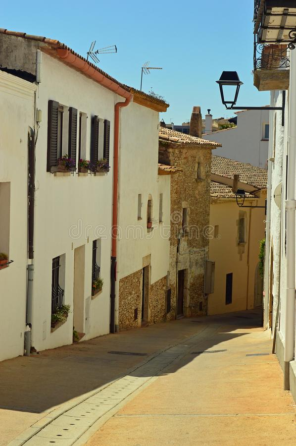 Begur - narrow white washed street. Positioned at the heart of the Empordà district, the town of Begur and its beaches are one of the most wonderful spots royalty free stock images