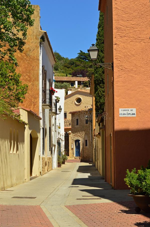Begur - narrow white washed street. Positioned at the heart of the Empordà district, the town of Begur and its beaches are one of the most wonderful spots stock photos