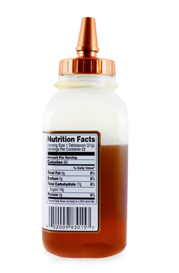 Behälter mit rohem Honig lizenzfreies stockbild