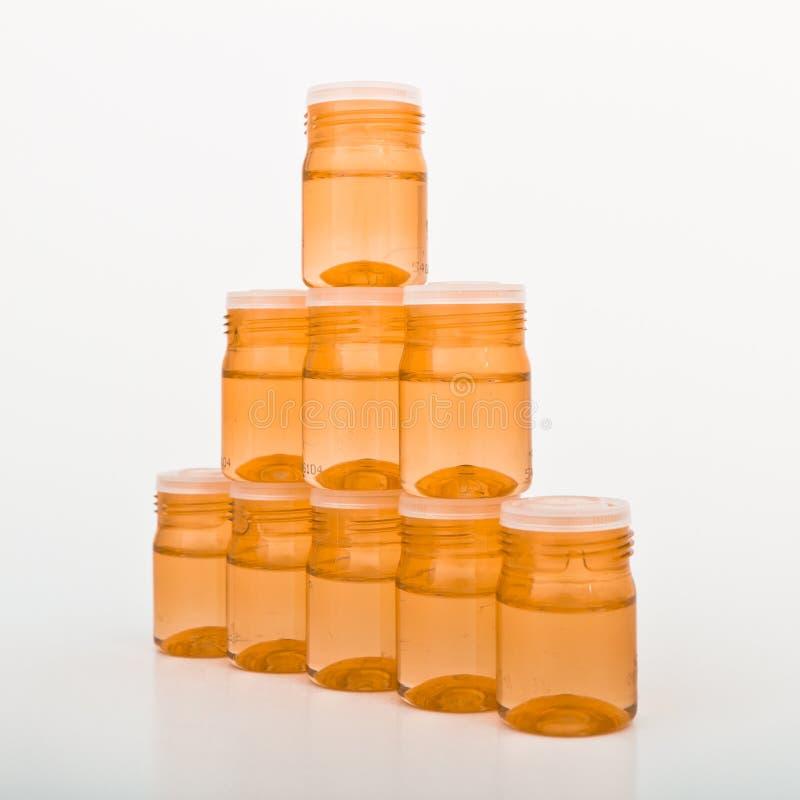 behållarecosmeticexponeringsglas royaltyfria foton