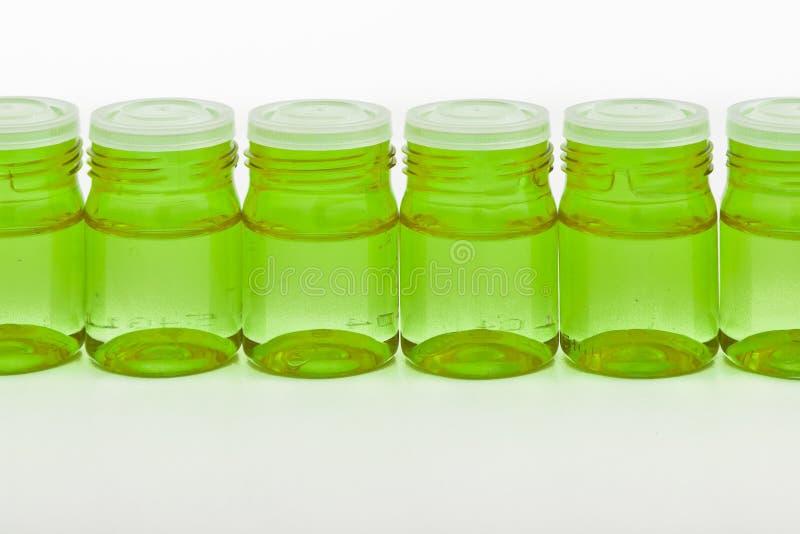 behållarecosmeticexponeringsglas royaltyfri fotografi
