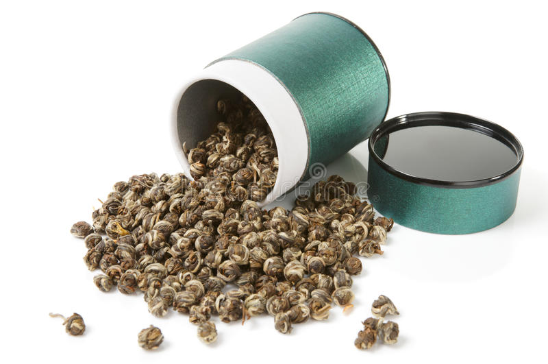 behållareelitoolong spillde tea royaltyfria foton