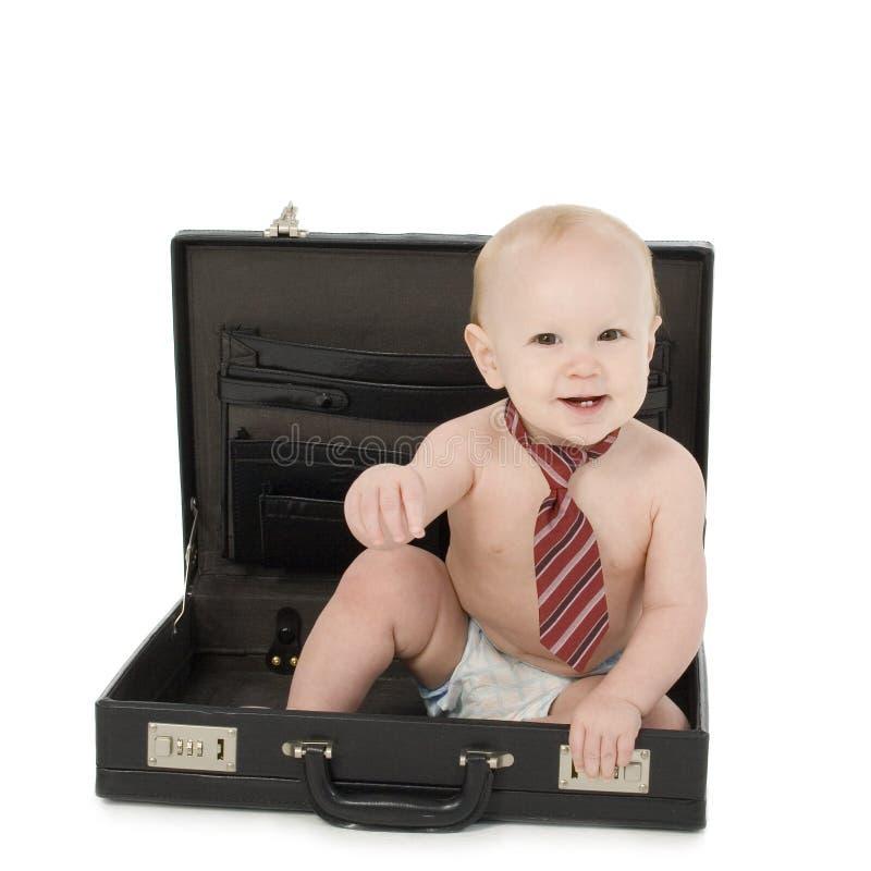 behandla som ett barn affärsmannen arkivbilder