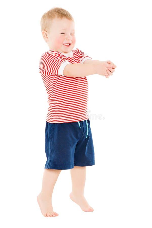 Behandla som ett barn den fulla längdståenden för pojken, den lyckliga ungen som står på årigt vitt roligt barn ett royaltyfri bild