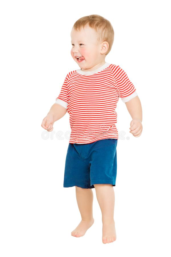 Behandla som ett barn den fulla längdståenden för pojken, den lyckliga ungen som står på vitt, årigt barn ett arkivbilder