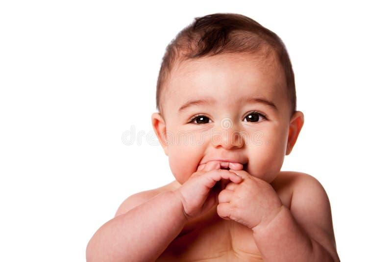 behandla som ett barn det gulliga framsidaspädbarn arkivfoto