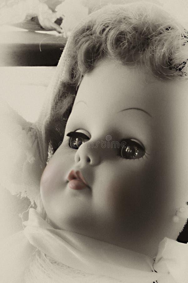 behandla som ett barn - dockakantpinken arkivbilder