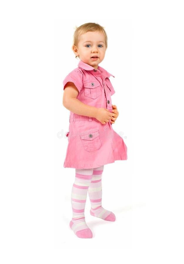 behandla som ett barn flickastandingen fotografering för bildbyråer