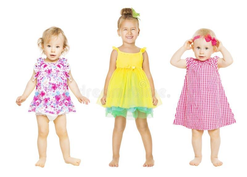 Behandla som ett barn flickor i klänning, ungar gruppen, litet barnbarn royaltyfria bilder