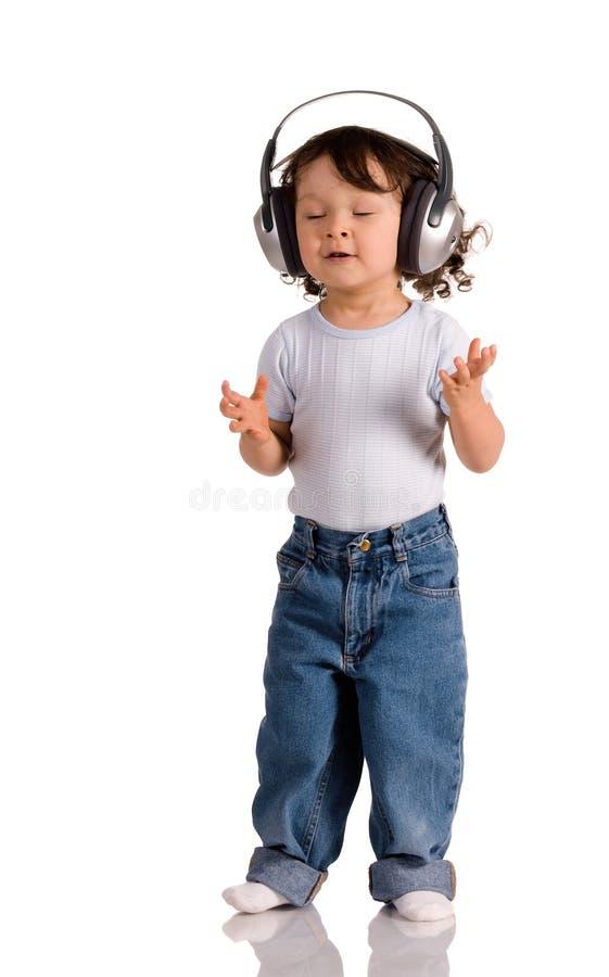 behandla som ett barn hörlurar arkivbild