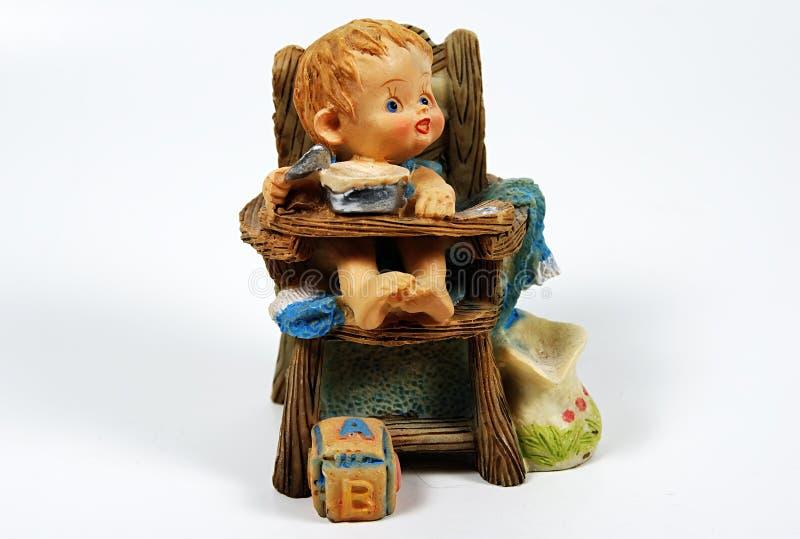 behandla som ett barn keramiskt arkivbild