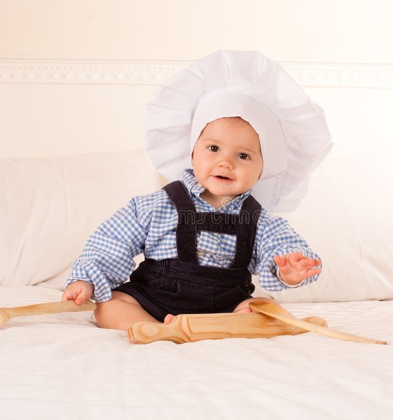 behandla som ett barn kocken royaltyfri fotografi
