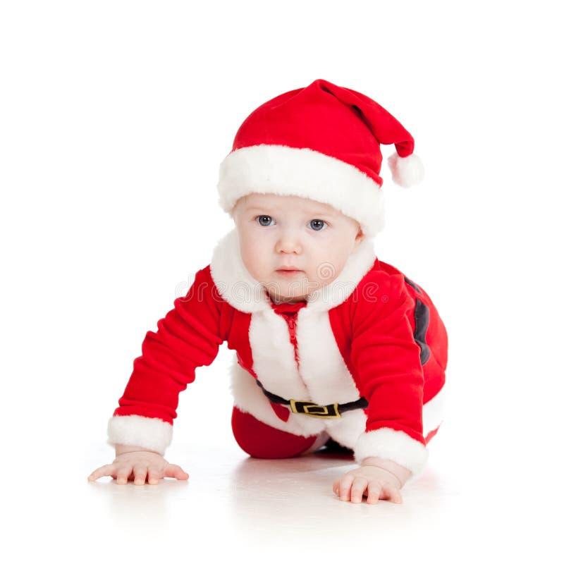Behandla som ett barn litet barn som kläs som Santa Claus över white royaltyfria foton