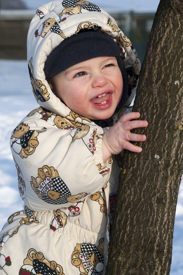 behandla som ett barn lycklig snow arkivbild