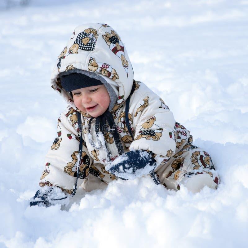 behandla som ett barn lycklig snow royaltyfri foto