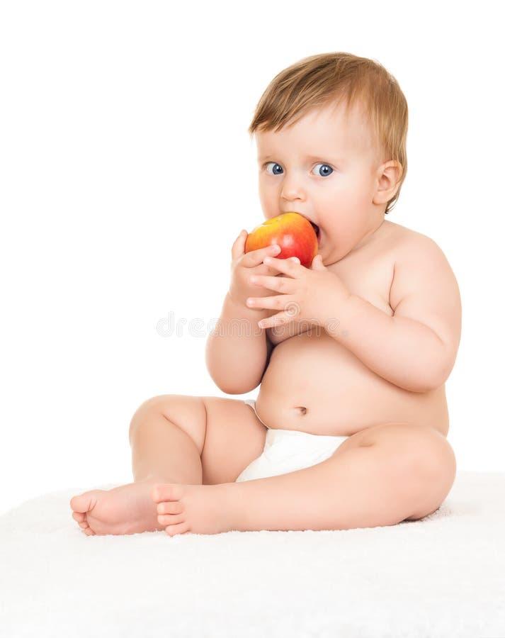 Behandla som ett barn med äpplet royaltyfria foton