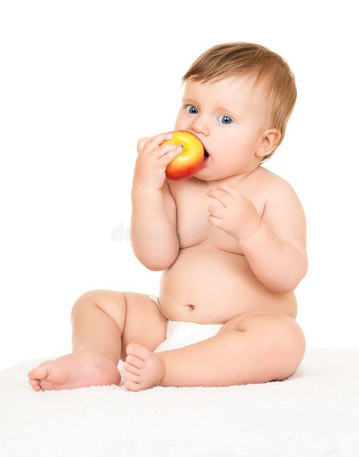 Behandla som ett barn med äpplet royaltyfri bild