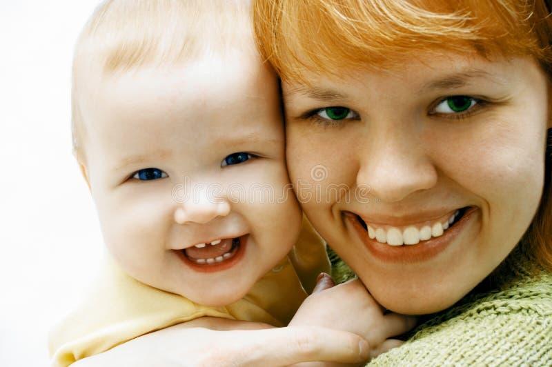 behandla som ett barn moderwhite arkivfoton