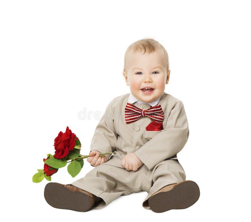 Behandla som ett barn pojkeblomman, dräkten för ungebrunnpåklädden, barnmodekläder royaltyfria foton