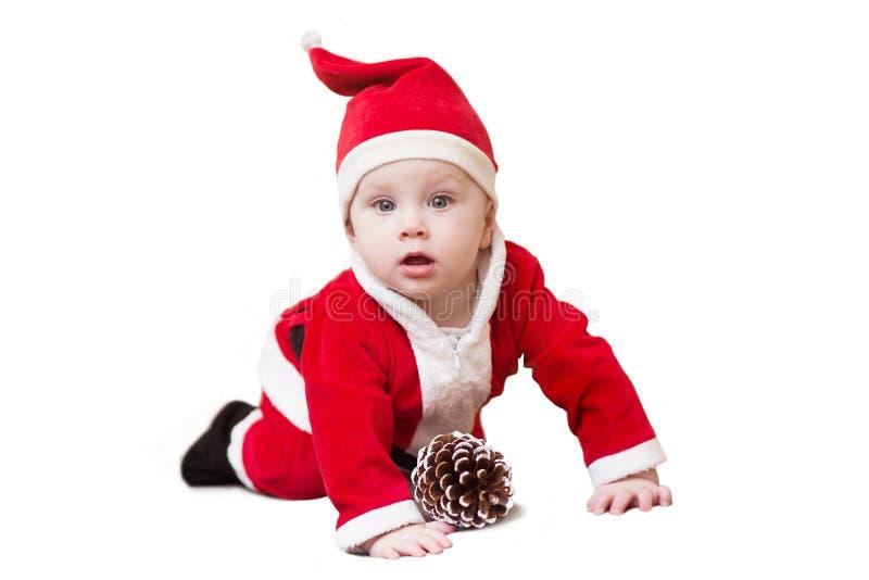 Behandla som ett barn pojken i jultomtendräkt Jul som isoleras på vit bakgrund fotografering för bildbyråer