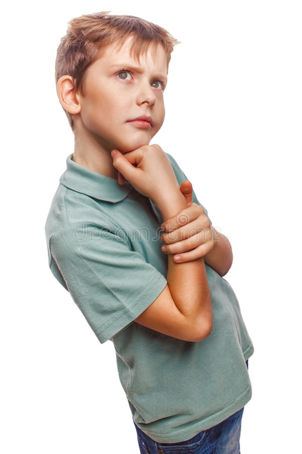 Behandla som ett barn pojken tänker lurvigt se för unge rufsat till arkivfoto