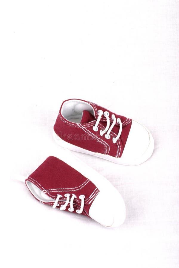 behandla som ett barn skor arkivfoton