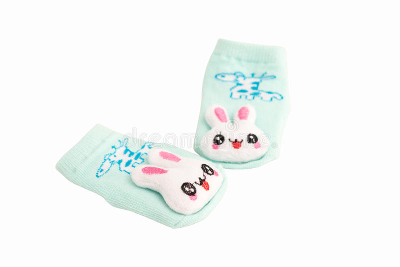 Behandla som ett barn sockor som isoleras på vit bakgrund arkivbild