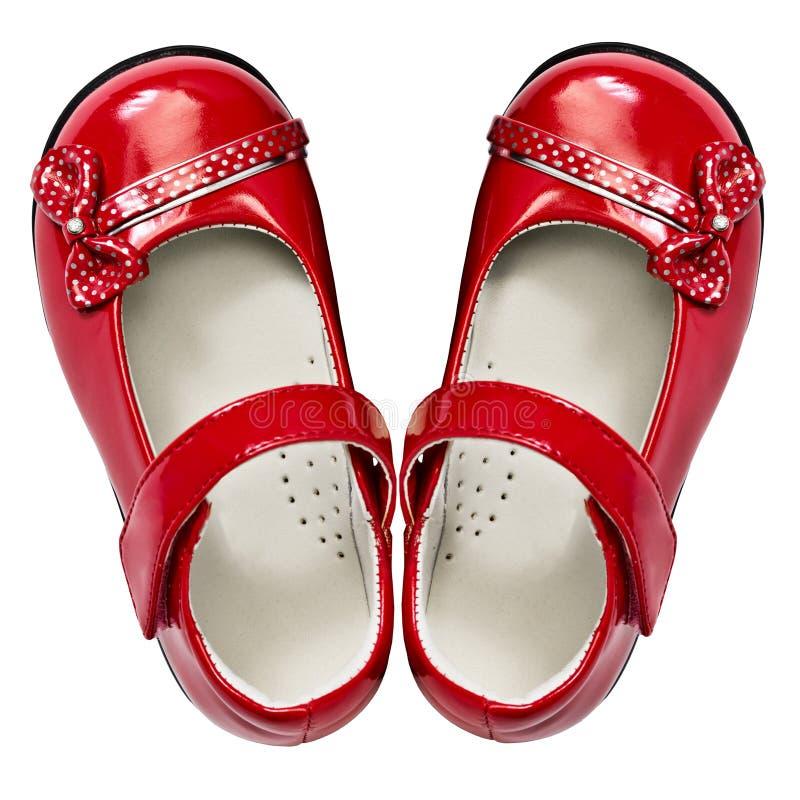 behandla som ett barn vita röda skor royaltyfria foton