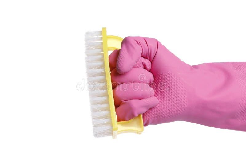 Behandschuhte Hand, die eine Bürste lokalisiert auf weißem Hintergrund hält stockfotos