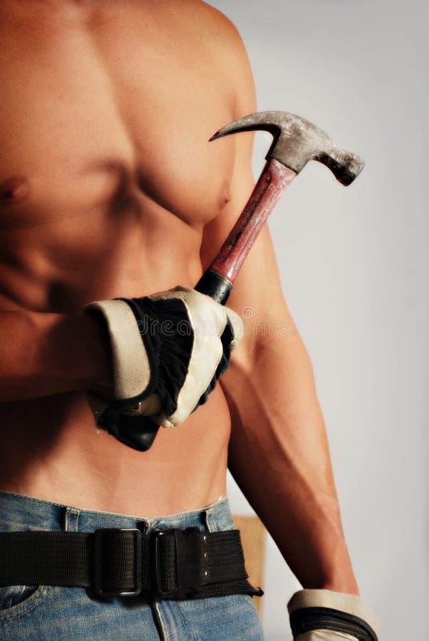Behandschuhter Bauarbeiter stockfoto