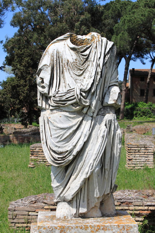 Beheaded statue of a roman senator stock images
