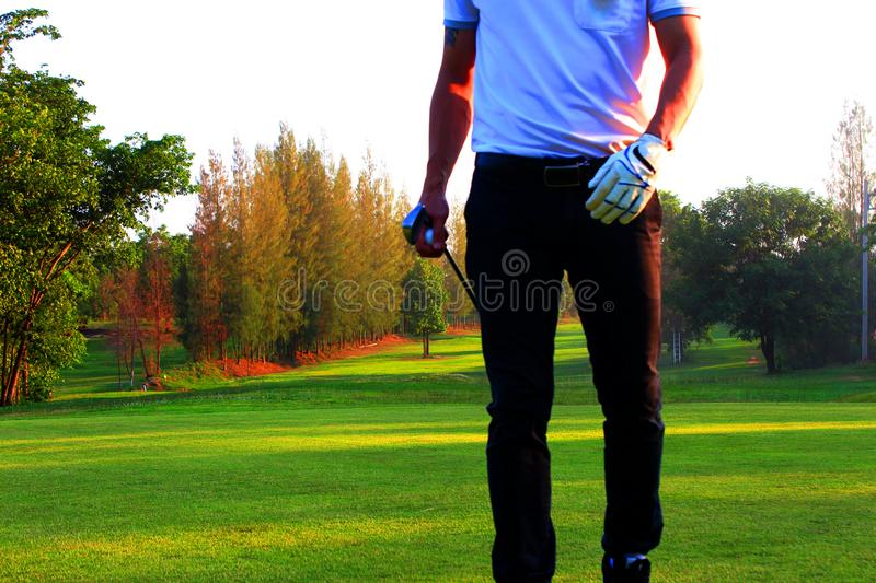Golf shooter hitting the golf ball stock image