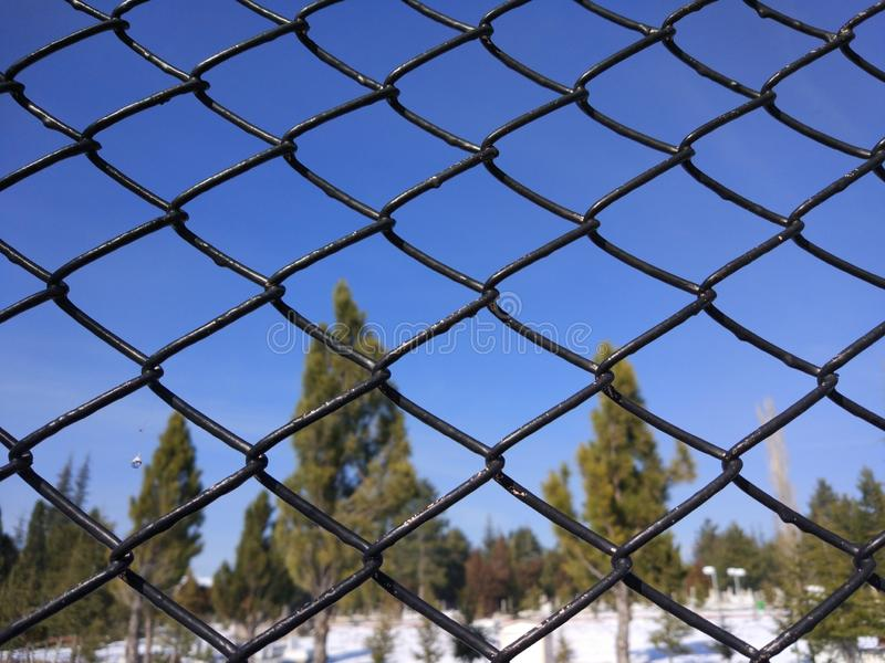 Behind the bars the landscape. Look through the landscape behind the bars royalty free stock images