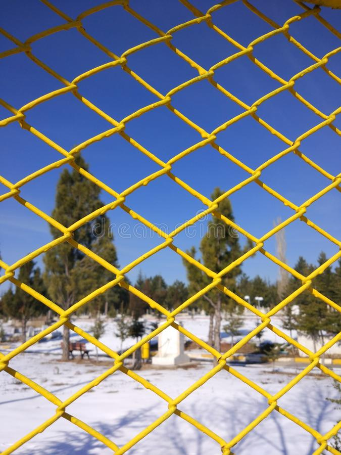 Behind the bars the landscape. Look through the landscape behind the bars royalty free stock photography