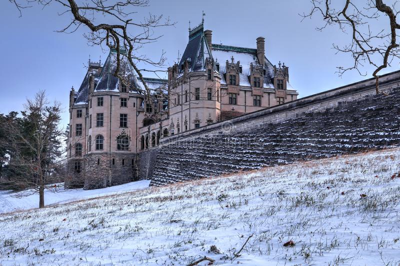 Behind Biltmore House In Snow. The Biltmore estate is locate in Asheville North Carolina. Home was built by George Washington Vanderbilt at the turn of the royalty free stock images