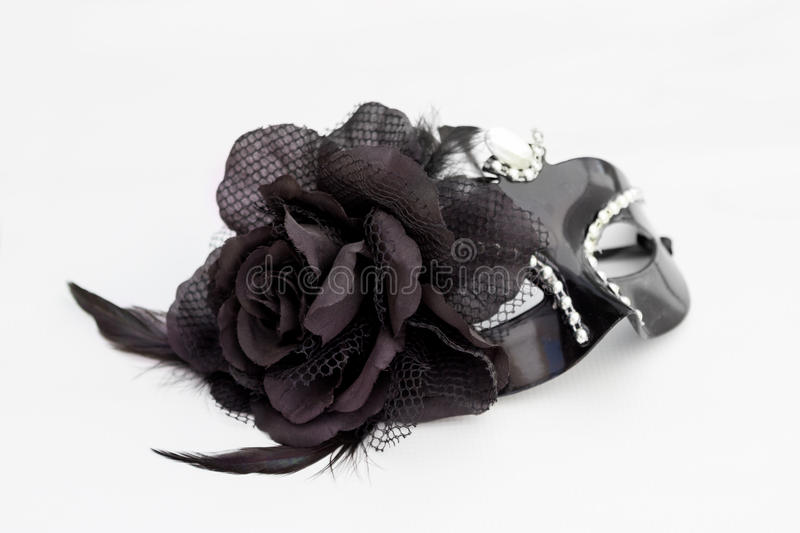 Behind the black mask royalty free stock photo