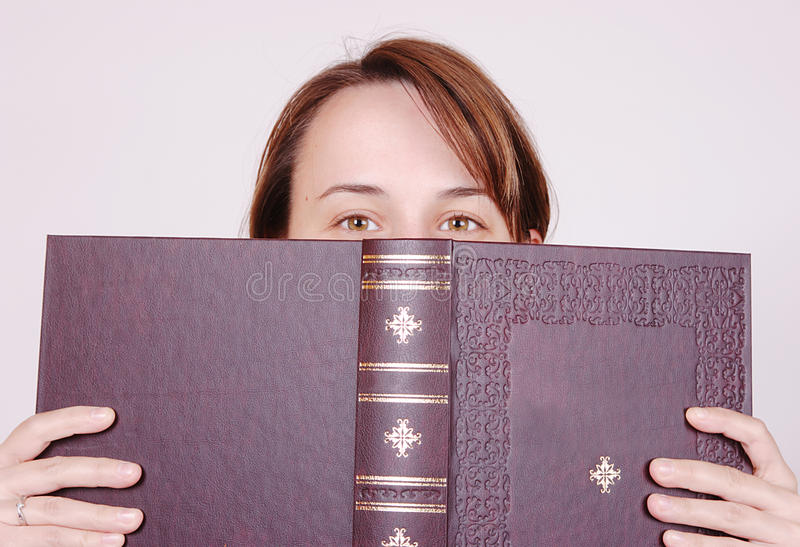 Behind the book royalty free stock photo
